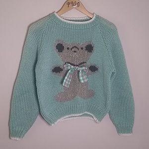 Evian II kawala bear green sweater size Med.